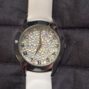 Watch with white band and glitter face.